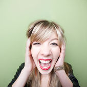Woman Screams With Ears Covered — Stock Photo