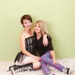 Two attractive teen punk girls happily pose as friends — Stock Photo