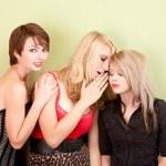 Attractive teen girls sharing secrets — Stock Photo