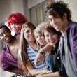 Stock Photo: Group of punk rock teens smile at camerwith focus on the