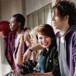 Beautiful young teen girl smiles for the camera as her friends l — Stock Photo