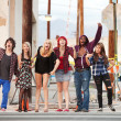 Group of young angry punk rock teens shout across street. — Stock Photo #40923277