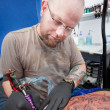 Stock Photo: Tattoo Artist Inks Design
