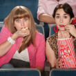 Amazed Women Eating Popcorn — Stock Photo