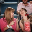 Stock Photo: Women Laugh in Theater