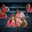Stock Photo: Bored People In Theater