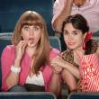 Women With Popcorn Holding Hands — Stock Photo