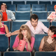 Rude MFlirts in Theater — Stock Photo #40923817