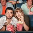 Scared Couple In Theater — Stock Photo #40924737