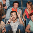 Audience Angry With Man on Phone — Stock Photo #40924845
