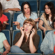Stock Photo: Disturbed Audience