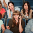 Woman On Phone Call In Theater — Stock Photo