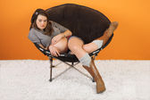 Serious Pregnant Woman in Chair — Stock Photo