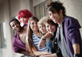 A group of punk rock teens smile at the camera with focus on the — Stock Photo