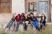 Young punk gang hanging out behind an abandoned urban building. — Stock Photo