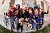 Angry teen punks shout towards the camera — Stock Photo
