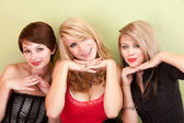 Three attractive teen girls pose with their hands — Stock Photo