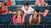 Man Flirting in Theater — Stock Photo