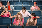 Rude Man Flirts in Theater — Stock Photo