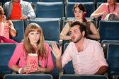 Man Talks to Woman in Theater — Stock Photo