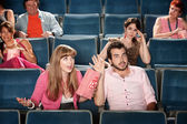 Couple Argue In a Theater — Stock Photo