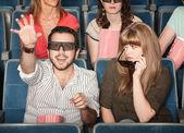 Girlfriend Annoyed With Boyfriend at Movies — Photo