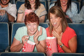 Laughing Women at Picture Show — Stock Photo