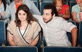 Guy Flirting in Theater — Stock Photo