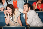 Embarrassed Girl in Theater — Stockfoto