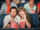Scared Couple In Theater — Stock Photo