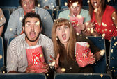 Scared People Tossing Popcorn — Stock Photo