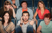 Man On Phone In Theater — Stock Photo