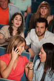 Women On Phone in Theater — Stock Photo
