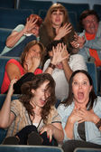 Frightened People in a Theater — Stock Photo