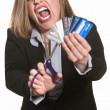 Stock Photo: Angry Lady Cuts Credit Cards