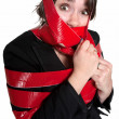 Stock Photo: WomIn Red Tape
