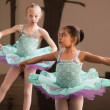 Stock Photo: Cute Ballet Students Twirling