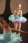 Young Ballet Student Watches Friend — Stock Photo