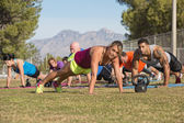 Group Doing Push-Ups with Instructor — Stock Photo