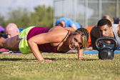 Embarrassed Woman Doing Push-Ups — Stock Photo