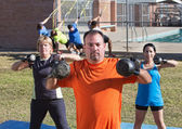 Adults Using Kettle Bell Weights — Stock Photo