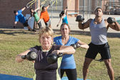 Mature Woman and Group Exercising Outdoors — Stock Photo