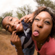 African-American family making faces — Stock Photo
