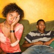 Stock Photo: Worried African-Americwomsitting with teen