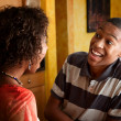 African-Americwomand teen laugh in kitchen — Stock Photo #41920431