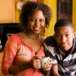 Stock Photo: African-Americfamily members in kitchen