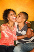 Happy African-American woman and teen boy — Stock Photo