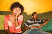 Worried African-American woman sitting with teen — Stock Photo