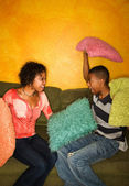 African-Americans having pillow fight — Stock Photo