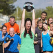 Smilng Lady Lifting Kettle Bell — Stock Photo